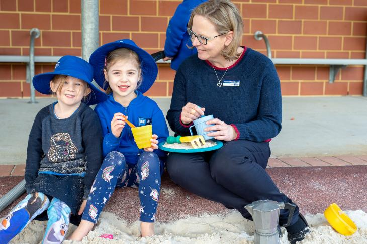 Yokine kindy students playing in sandpit with teacher